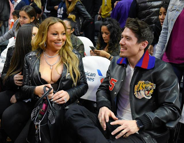 Mariah Carey and Bryan Tanaka attend a basketball game between the Atlanta Hawks and the Los Angeles Clippers at Staples Center on Feb. 15, 2017.  (Photo: Noel Vasquez/Getty Images)