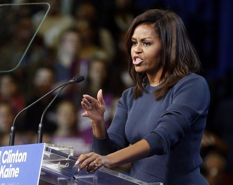 First lady Michelle Obama speaks during a campaign rally for Hillary Clinton, Oct. 13, 2016, in Manchester, N.H. (Photo: Jim Cole/Associated Press)
