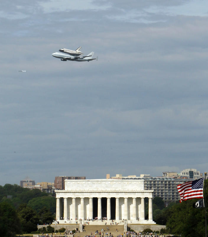 The Space Shuttle Discovery, mounted on the Shuttle Carrier Aircraft, flies over the Lincoln Memorial in Washington, Tuesday, April 17, 2012. Discovery is en route from Kennedy Space Center to the Smithsonian National Air and Space Museum Udvar/Hazy Center at Dulles International Airport. The oldest surviving shuttle, Discovery holds the all-time record with 39 missions, 148 million miles, 5,830 orbits of Earth, and 365 days spent in space. All that was achieved in under 27 years. (AP Photo/Ann Heisenfelt)
