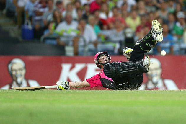 Steven Smith of the Sixers is hit by the ball as he dives to make his ground during the Big Bash League match between Sydney Thunder and the Sydney Sixers at ANZ Stadium on December 30, 2012 in Sydney, Australia.  (Photo by Mark Kolbe/Getty Images)