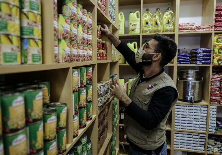 A volunteer from the Lebanese charity Beit El Baraka sorts food stocks to be distributed to the needy, at the organisation's headquarters in Beirut