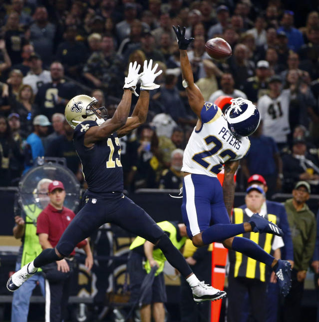 Los Angeles Rams cornerback Marcus Peters (22) breaks up a pass intended for New Orleans Saints wide receiver Michael Thomas (13) in the first half of an NFL football game in New Orleans, Sunday, Nov. 4, 2018. (AP Photo/Butch Dill)