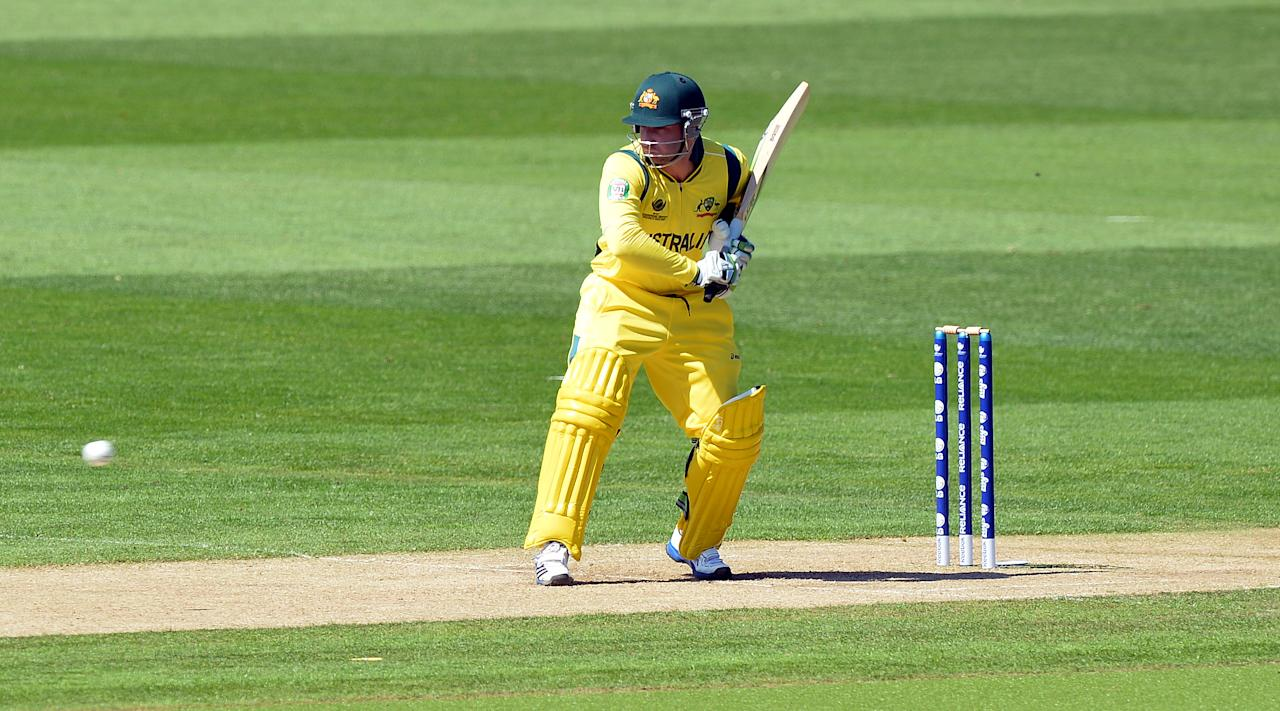 Australia's Phil Hughes plays a shot during the warm-up cricket match ahead of the 2013 ICC Champions Trophy between India and Australia at The Cardiff Wales Stadium in Cardiff, Wales on June 4, 2013.  India won by 243 runs. AFP PHOTO/Paul ELLIS        (Photo credit should read PAUL ELLIS/AFP/Getty Images)
