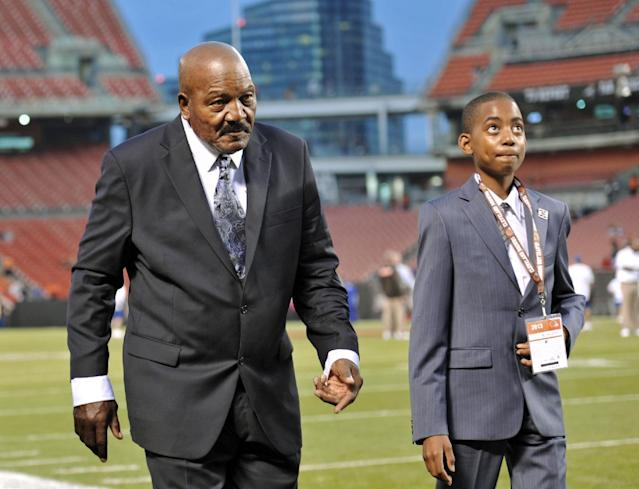 Cleveland Browns Hall of Fame running back Jim Brown walks the sidelines before an NFL football game between the Browns and the Buffalo Bills on Thursday, Oct. 3, 2013, in Cleveland. The Browns planned to honor Brown at halftime. (AP Photo/David Richard)