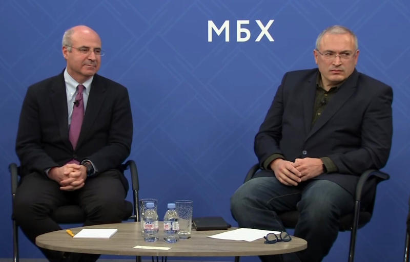 "In this image made from video, Kremlin critic Mikhail Khodorkovsky, right, and financier William Browder attend a joint press conference in London, Tuesday, Nov. 20, 2018. Kremlin foes including financier Bill Browder, Mikhail Khodorkovsky and Alexei Navalny have warned that naming a top Russian police official to the job would undermine Interpol. Russian Interior Ministry spokesman Irina Volk lashed out at critics, accusing them of running a ""campaign to discredit"" the Russian candidate Alexander Prokopchuk. (AP Photo)"
