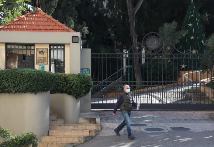A man walks near the entrance of the Lebanese American University (LAU) in Beirut