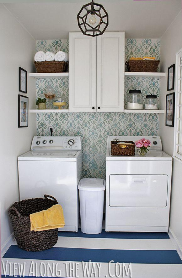 """<p>To stay within her $100 budget, she opted for yard sale cabinets with built-in open shelving on the sides. She then used wicker baskets and glass containers to pretty-up the items that couldn't stay concealed.</p><p><em><a href=""""http://www.viewalongtheway.com/2013/01/laundry-room-reveal/"""" rel=""""nofollow noopener"""" target=""""_blank"""" data-ylk=""""slk:See more at View Along the Way »"""" class=""""link rapid-noclick-resp"""">See more at View Along the Way »</a></em></p><p><span class=""""redactor-invisible-space""""><span class=""""redactor-invisible-space""""><strong>What you'll need:</strong> wallpaper, $2 per square foot, <a href=""""https://www.wayfair.com/Brewster-Home-Fashions-Plume-33-x-20.5-Watercolor-Wallpaper-BZH7267.html"""" rel=""""nofollow noopener"""" target=""""_blank"""" data-ylk=""""slk:wayfair.com"""" class=""""link rapid-noclick-resp"""">wayfair.com</a></span></span><br></p>"""