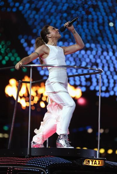 LONDON, ENGLAND - AUGUST 12: Melanie Chisholm of The Spice Girls performs during the Closing Ceremony on Day 16 of the London 2012 Olympic Games at Olympic Stadium on August 12, 2012 in London, England. (Photo by Hannah Johnston/Getty Images)