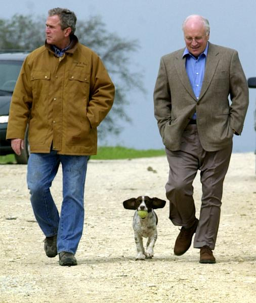 "FILE- This Nov. 11, 2000 file photo shows then Republican presidential candidate Texas Gov. George W. Bush and running mate Dick Cheney walk down a dirt road to meet with reporters, followed by Bush's dog Spot, near Crawford, Texas. For the new book ""Pets at the White House,"" Dallas author Jennifer Boswell Pickens interviewed everyone from first family members to White House staffers to give readers a glimpse at what life is like at 1600 Pennsylvania Ave. for pets and what those pets have meant to their famous owners. (AP Photo/Eric Draper, file)"