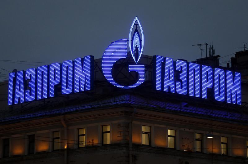 The company logo of Russian natural gas producer Gazprom is seen on an advertisement installed on the roof of a building in St. Petersburg