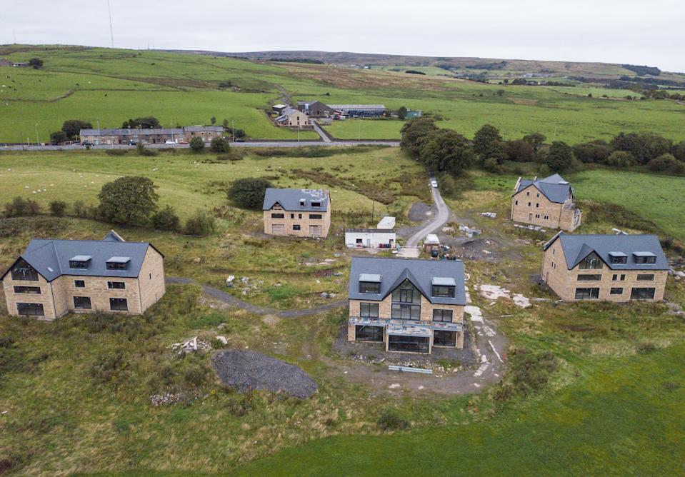 Drone images of mansions under threat of demolition, Bolton, Lancs. See SWNS story SWLEhouses; The owners of five luxury mansions which were built too big and in the wrong place face the threat of having their million-pound homes demolished. Residents wanted to broker a deal with a local council after it was found the properties were not built in accordance with planning permission. It had been hoped council chiefs would wave through the latest application after it was recommended for approval by town planners. But the revised plans, which involved knocking down and rebuilding two properties and reducing the size of another at a cost of more than £1m, was last week thrown out by councillors.