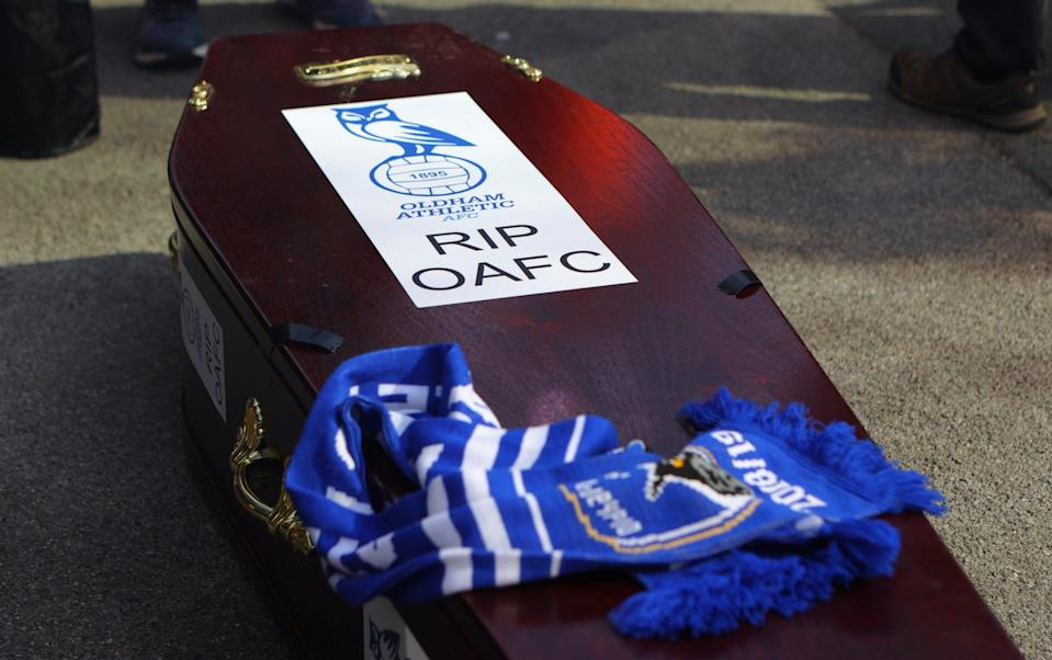 coffin is seen outside the stadium as fans protest against Oldham Athletic owner Abdallah Lemsagem - James Gill/Getty Images