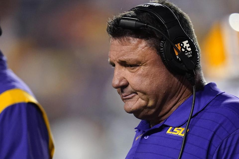 LSU coach Ed Orgeron walks on the sideline during a timeout against Auburn on Saturday.