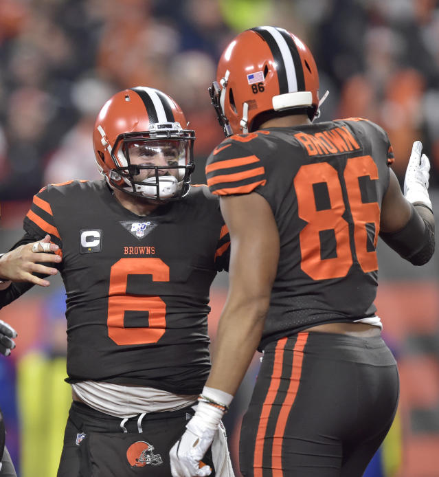 Cleveland Browns quarterback Baker Mayfield (6) celebrates with tight end Pharaoh Brown (86) after Mayfield scored a 1-yard touchdown during the first half of the team's NFL football game against the Pittsburgh Steelers, Thursday, Nov. 14, 2019, in Cleveland. (AP Photo/David Richard)
