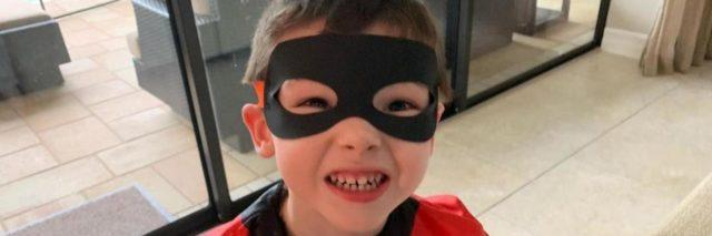 Little boy wearing costume of the Incredibles