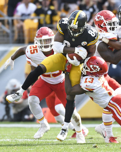 In this Sunday, Sept. 16, 2018 photo, Pittsburgh Steelers wide receiver Antonio Brown (84) is hit by Kansas City Chiefs' De'Anthony Thomas (13) during an NFL football game in Pittsburgh. The Steelers began the season saying they needed to avoid the drama that plagued them in 2017. And yet two weeks in the team is winless, Antonio Brown is frustrated and Le'Veon Bell is MIA. (AP Photo/Don Wright)