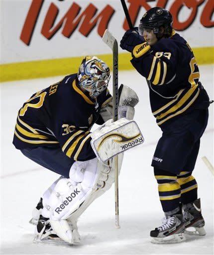 Buffalo Sabres goalie Ryan Miller celebrates his shutout with teammate Tyler Ennis (63) against the Boston Bruins, after an NHL hockey game in Buffalo, N.Y., Wednesday, Feb. 8, 2012. The Sabres won 6-0. (AP Photo/David Duprey)