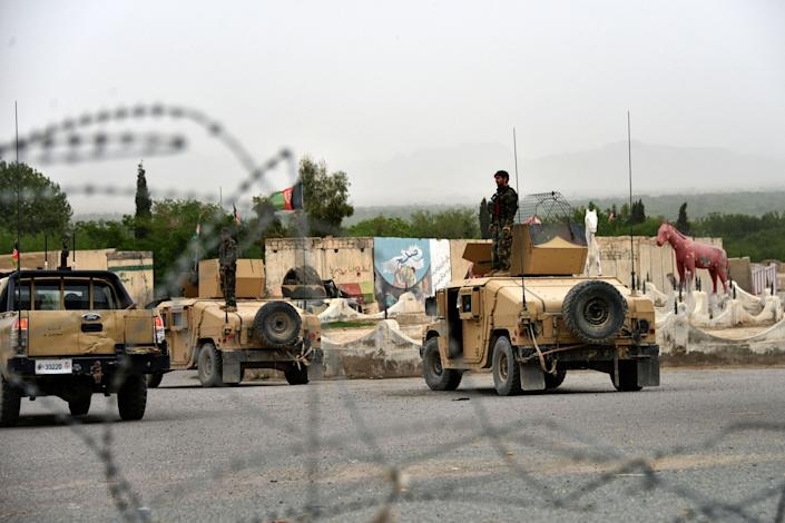 Afghan security forces stand onHumvees during a military operation in the Arghandab district of Kandahar province on April 4, 2021. (Photo: JAVED TANVEER via Getty Images)