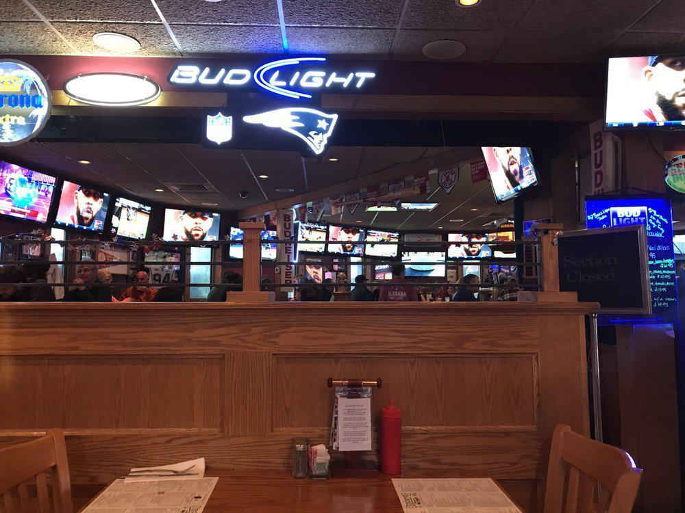 """<p>The best sports bar in New Hampshire features wall-to-wall televisions, with more than 65 screens in all. On top of every game you could want and friendly service, Billy's menu boasts lots of large, shareable snacks from nachos to quintessential <a href=""""https://www.thedailymeal.com/entertain/instant-pot-game-day-recipes-slideshow?referrer=yahoo&category=beauty_food&include_utm=1&utm_medium=referral&utm_source=yahoo&utm_campaign=feed"""">game day dips</a>.</p>"""