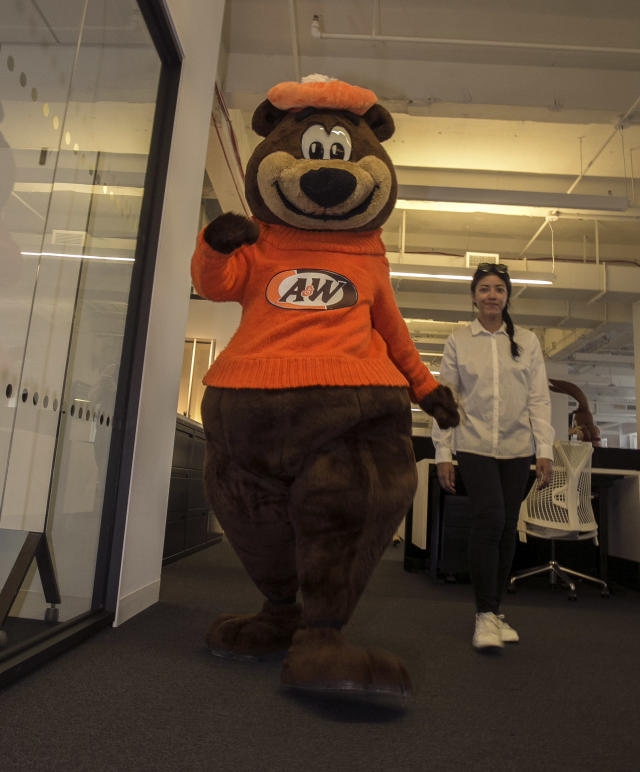 <p>A&W company mascot Rooty the Great Root Bear heads down the hall at Yahoo Studios in New York City on Sept. 25, 2017. (Photo: Gordon Donovan/Yahoo News) </p>