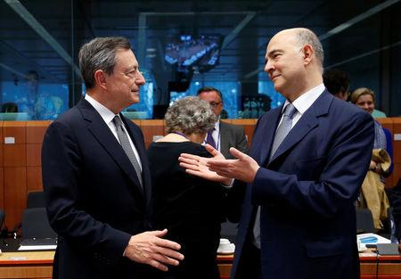 European Central Bank (ECB) President Mario Draghi and European Economic and Financial Affairs Commissioner Pierre Moscovici (R) attend a eurozone finance ministers meeting in Brussels, Belgium May 22, 2017. REUTERS/Francois Lenoir