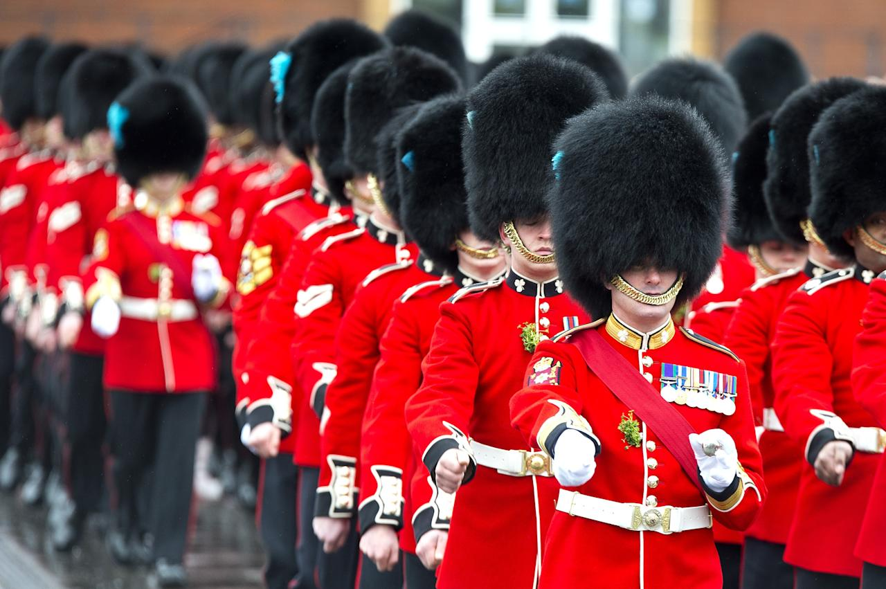 ALDERSHOT, ENGLAND - MARCH 17:  A march is performed during The Irish Guards' St Patrick's Day Parade at Mons Barrackson March 17, 2013 in Aldershot, England.  (Photo by Ben Pruchnie/Getty Images)
