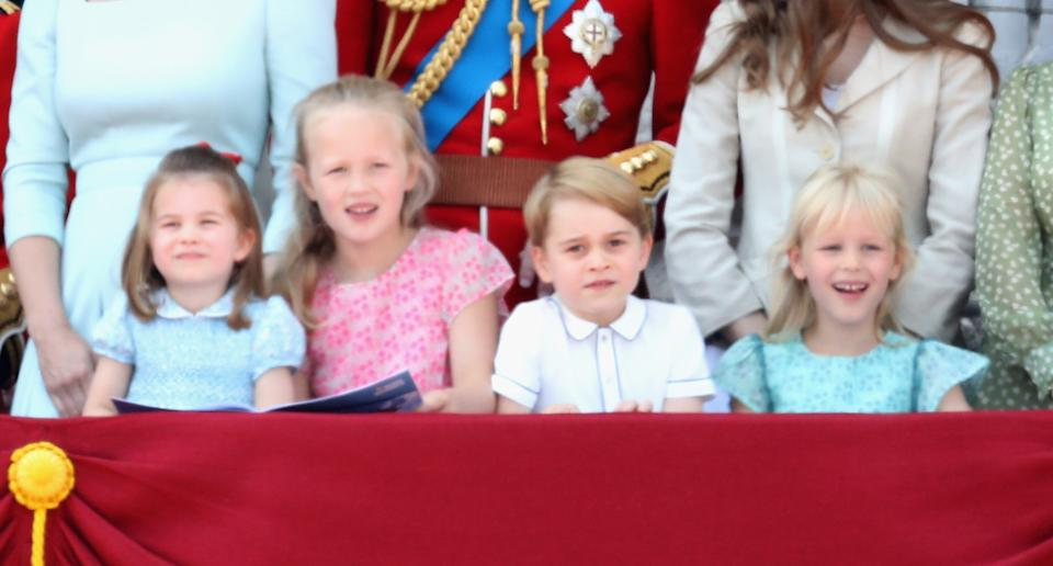 LONDON, ENGLAND - JUNE 09:  Princess Charlotte of Cambridge, Savannah Phillips, Prince George of Cambridge and Isla Phillips watch the flypast on the balcony of Buckingham Palace during Trooping The Colour on June 9, 2018 in London, England. The annual ceremony involving over 1400 guardsmen and cavalry, is believed to have first been performed during the reign of King Charles II. The parade marks the official birthday of the Sovereign, even though the Queen's actual birthday is on April 21st.  (Photo by Chris Jackson/Getty Images)