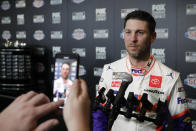 Denny Hamlin answers questions form members of the media during NASCAR Daytona 500 auto racing media day at Daytona International Speedway, Wednesday, Feb. 12, 2020, in Daytona Beach, Fla. (AP Photo/John Raoux)