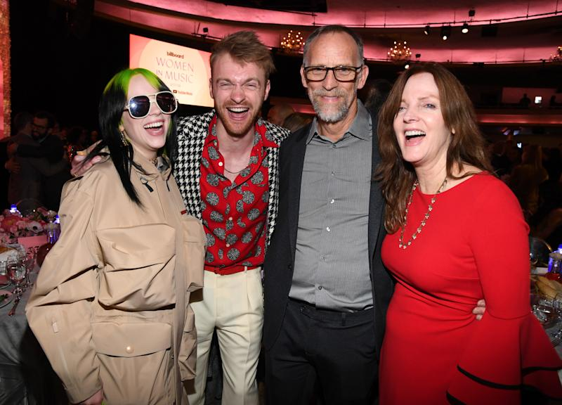 Billie Eilish, Finneas O'Connell, Patrick O'Connell and Maggie Baird attend Billboard Women In Music 2019, presented by YouTube Music, on December 12, 2019 in Los Angeles, California. (Photo by Kevin Mazur/Getty Images for Billboard)