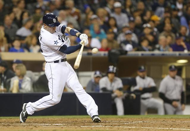 San Diego Padres' Chris Denorfia rips a double down the right field line that drives in a run against the Colorado Rockies in the fifth inning of a baseball game Wednesday, April 16, 2014, in San Diego. (AP Photo/Lenny Ignelzi)