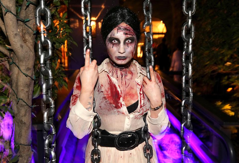 Demi Lovato proves that dressing up as a zombie for Halloween is a classic for a reason. Go heavy on the black eyeliner, smudge fake blood all over your face, and…well, that's really all there is to it.
