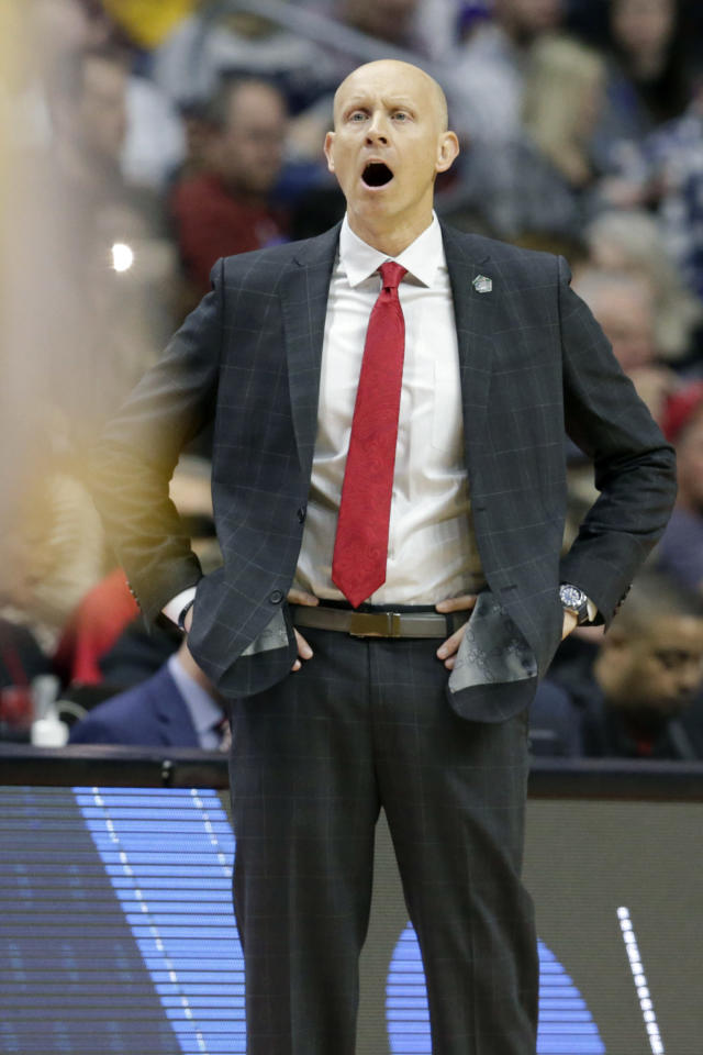 Louisville coach Chris Mack calls instructions during the first half of a first round men's college basketball game against Minnesota in the NCAA Tournament, in Des Moines, Iowa, Thursday, March 21, 2019. (AP Photo/Nati Harnik)