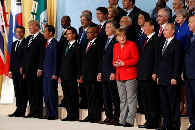 <p>French President Emmanuel Macron, U.S. President Donald Trump, Indonesia's President Joko Widodo, Mexico's President Enrique Pena Nieto, South African President Jacob Zuma, Argentina's President Mauricio Macri, German Chancellor Angela Merkel, Chinese President Xi Jinping, Russian President Vladimir Putin, Turkish President Recep Tayyip Erdogan, Britain's Prime Minister Theresa May, Australian Prime Minister Malcolm Turnbull, Japanese Prime Minister Shinzo Abe, India's Prime Minister Narendra Modi, Canadian Prime Minister Justin Trudeau, Italian Prime Minister Paolo Gentiloni and other leaders pose for a family photo at the G20 leaders summit in Hamburg, Germany July 7, 2017. (Photo: Wolfgang Rattay/Reuters) </p>
