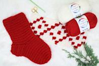 """<p>If you enjoy wearing warm Nordic sweaters every winter, this crochet stocking pattern is for you. Showing off red and white hues with a Scandinavian design, this stocking is just meant for Christmas. </p><p><strong>Get the tutorial at <a href=""""https://makeanddocrew.com/free-crochet-christmas-stocking-pattern/"""" rel=""""nofollow noopener"""" target=""""_blank"""" data-ylk=""""slk:Make & Do Crew"""" class=""""link rapid-noclick-resp"""">Make & Do Crew</a>.</strong></p><p><a class=""""link rapid-noclick-resp"""" href=""""https://www.amazon.com/Knitting-Crochet-Locking-Markers-Counter/dp/B06XCBTNBQ/ref=sr_1_5?tag=syn-yahoo-20&ascsubtag=%5Bartid%7C10050.g.28872655%5Bsrc%7Cyahoo-us"""" rel=""""nofollow noopener"""" target=""""_blank"""" data-ylk=""""slk:SHOP STITCH MARKERS"""">SHOP STITCH MARKERS</a></p>"""