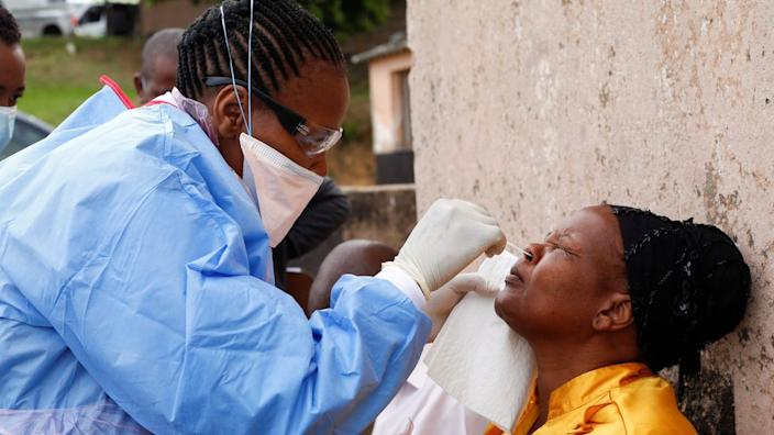A health worker carries out a door-to-door testing near Durban in South Africa