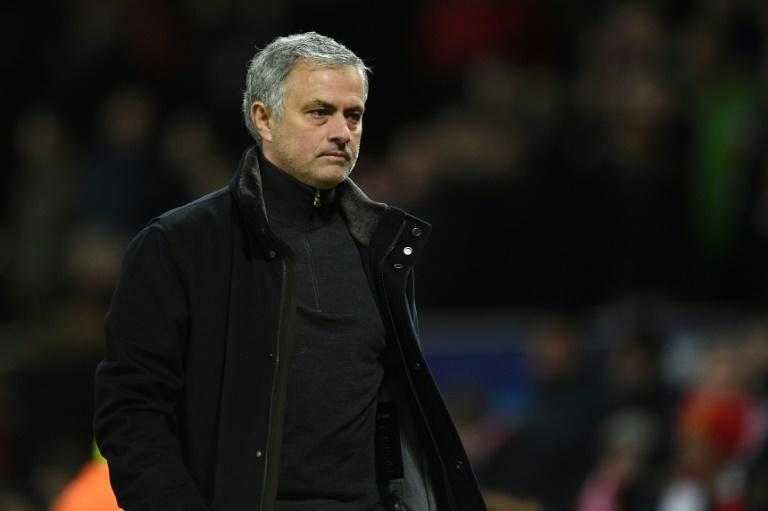 Manchester United's manager Jose Mourinho leaves the pitch after losing a last 16 second leg UEFA Champions League football match against Sevilla at Old Trafford in Manchester, northwest England on March 13, 2018