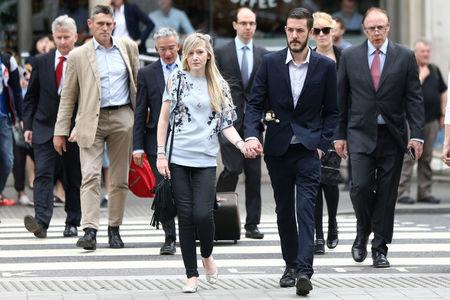 The parents of critically ill baby Charlie Gard, Connie Yates and Chris Gard, arrive at the High Court in London, Britain July 14, 2017. REUTERS/Neil Hall
