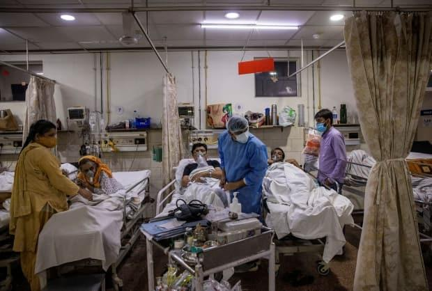 Medical staff work long hours with dwindling resources as COVID infections explode in India. People watching the news in Saskatchewan say they feel helpless. (Danish Siddiqui/Reuters - image credit)