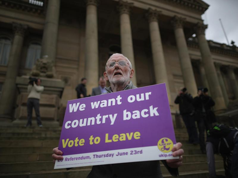 A Vote to Leave campaigner holds a placard in support of leaving the European Union in Bolton, England: Getty