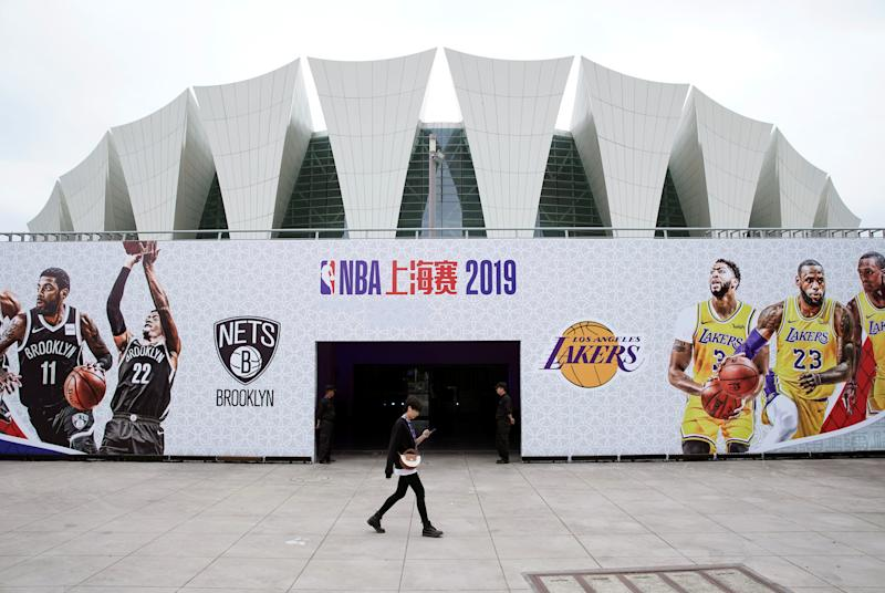A woman walks past an entrance of the venue that was scheduled to hold fan events ahead of an NBA China game between Brooklyn Nets and Los Angeles Lakers, at the Oriental Sports Center in Shanghai, China October 9, 2019. REUTERS/Aly Song