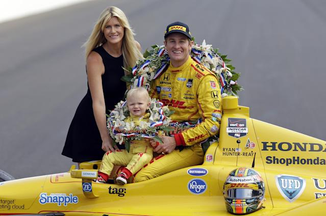 Indianapolis 500 champion Ryan Hunter-Reay poses with his wife Beccy Gordon and son Ryden during the traditional winners photo session on the start/finish line at the Indianapolis Motor Speedway in Indianapolis, Monday, May 26, 2014. Hunter-Reay won the 98th running of the Indianapolis 500 IndyCar auto race on Sunday. (AP Photo/Michael Conroy)