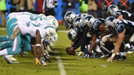 Nov 13, 2017; Charlotte, NC, USA; Miami Dolphins and Carolina Panthers at the line in the fourth quarter. The Panthers defeated the Dolphins 45-21 at Bank of America Stadium. Bob Donnan-USA TODAY Sports