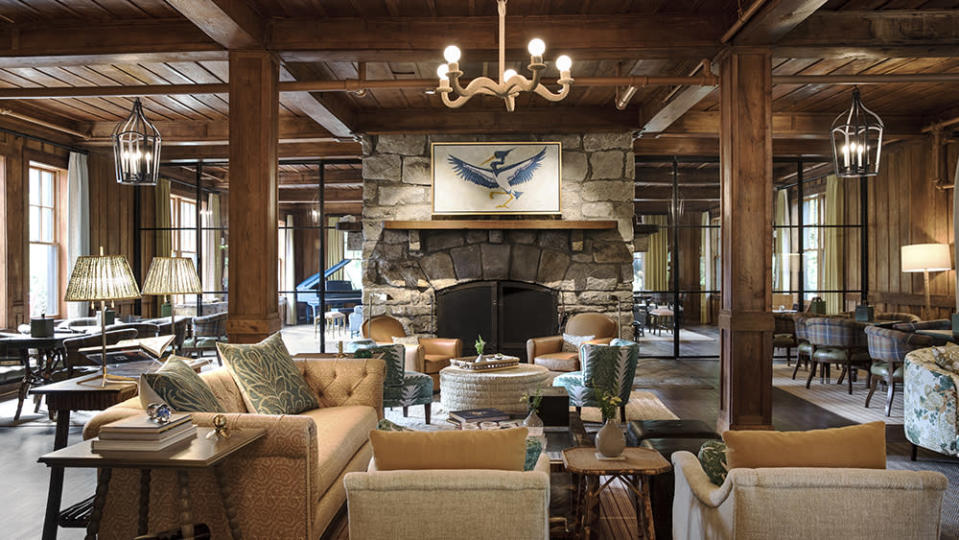 The original 1930s lobby lounge, with its four-sided fireplace, was renovated by the Blackberry Farm design unit. - Credit: Ball & Albanese