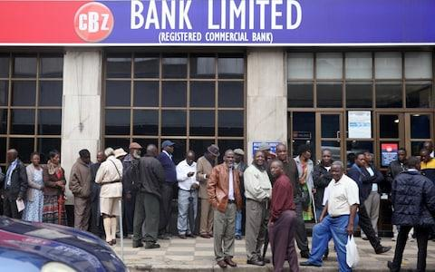Zimbabweans queue to withdraw money in Harare - Credit: PHILIMON BULAWAYO/Reuters