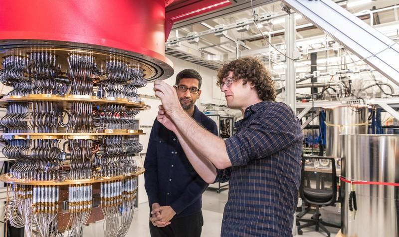 A handout picture shows Pichai and Sank with one of Google's Quantum Computers in the Santa Barbara lab