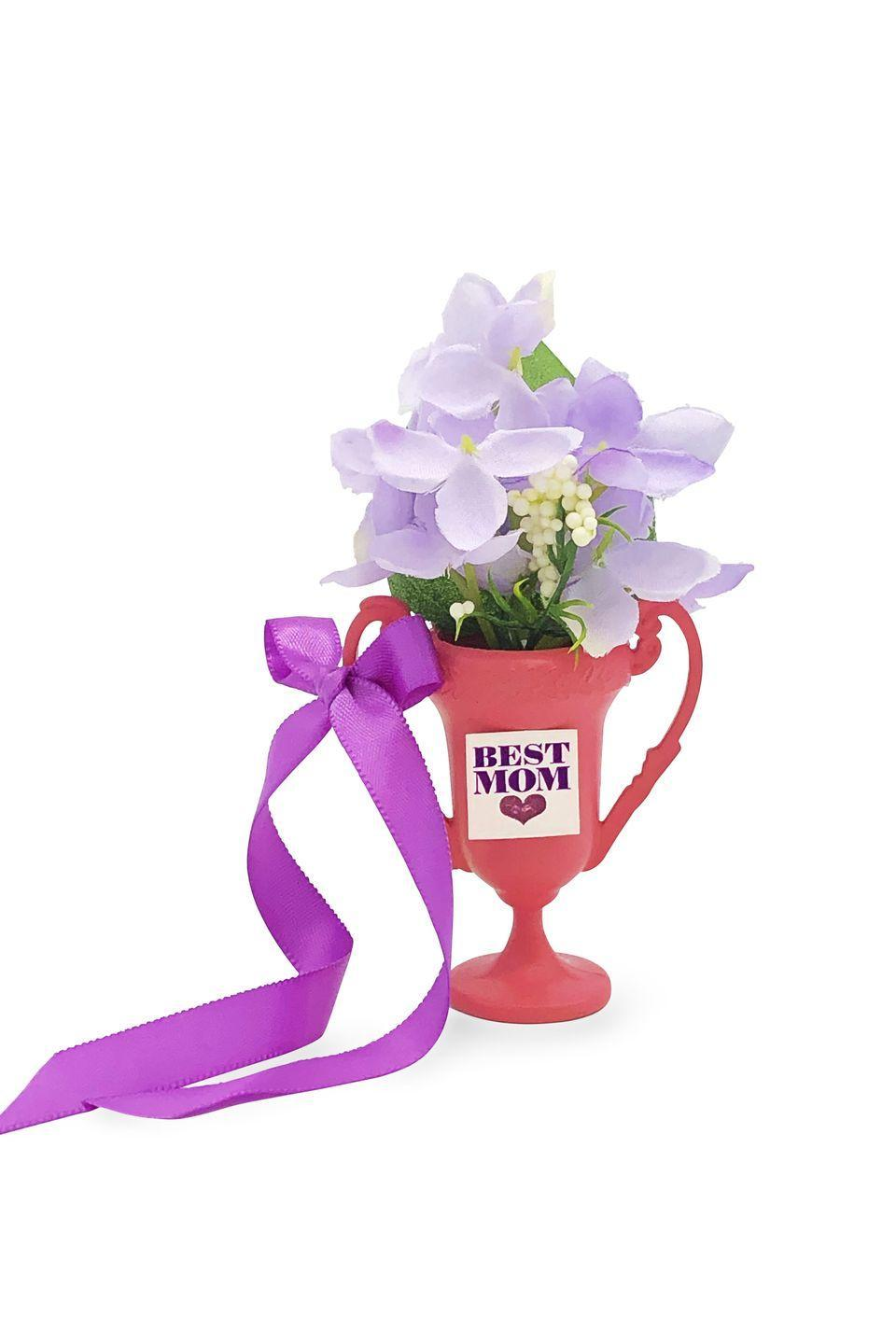 """<p>Cover a small plastic trophy with pink spray paint and let dry before gluing on a """"best mom"""" sign, and filling the trophy with flowers. A total winner!</p>"""