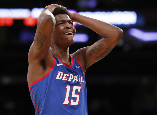 DePaul forward Paul Reed (15) reacts after drawing a foul for interrupting a three-point shot by Marquette during the first half of an NCAA college basketball game in the first round of the Big East conference tournament, in New York, Wednesday, March, 7, 2018. (AP Photo/Kathy Willens)