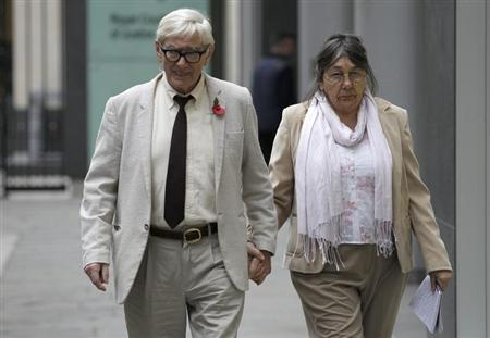 Hotel owners Peter and Hazelmary Bull walk outside a branch of the High Court in central London