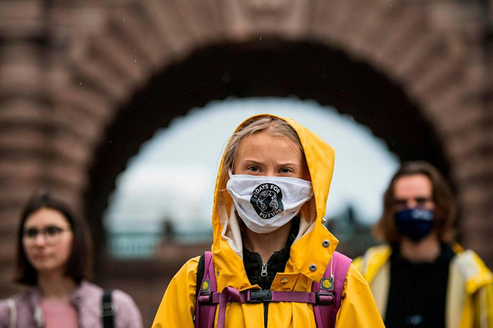 """Swedish climate activist Greta Thunberg protests during a """"Fridays for Future"""" demonstration in front of the Swedish Parliament Riksdagen in Stockholm on Oct. 9, 2020."""