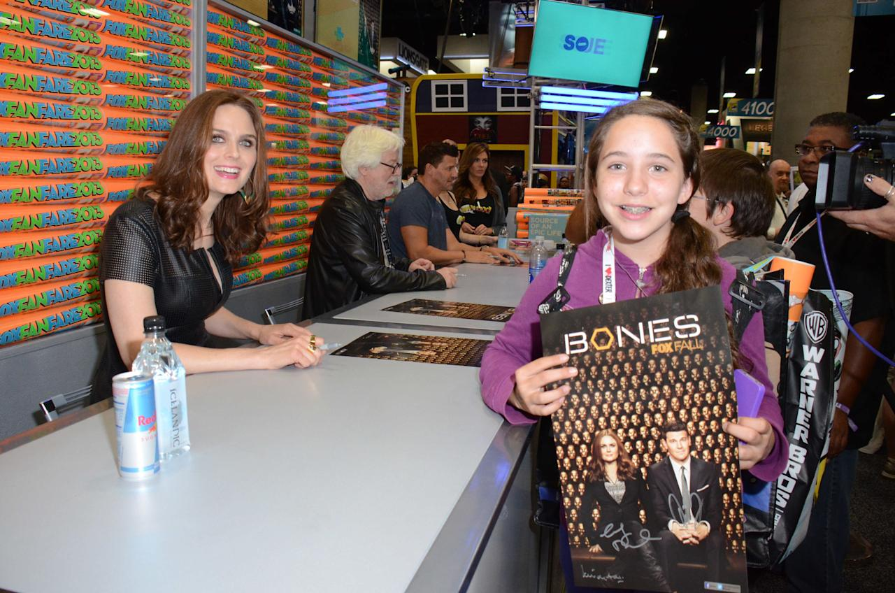"Emily Deschanel greets and signs an exclusive limited edition ""Bones"" poster for fans on Friday, July 19 during Fox Fanfare at San Diego Comic-Con 2013."